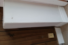no fill in holes. gapped baseboard. paint on tile and wall